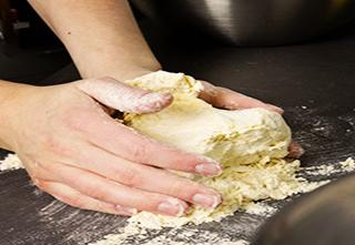 Mary O'Hanlon preparing dough